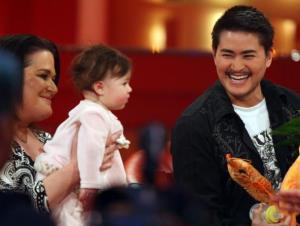 Thomas Beatie and his wife, Nancy, appear on a German TV program with the first of their three babies.