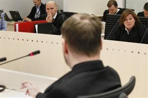 Anders Behring Breivik, back to camera, looks across to his defence lawyers at the start of the 5th day of his trial today.