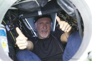 James Cameron gives two thumbs-up as he emerges from the Deepsea Challenger submersible March 26, after his successful solo dive in the Mariana Trench, the deepest part of the ocean.