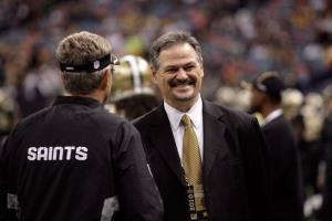 General manager Mickey Loomis of the New Orleans Saints talks to a coach prior to the game against the Pittsburgh Steelers at the Louisiana Superdome on October 31, 2010 in New Orleans, La.