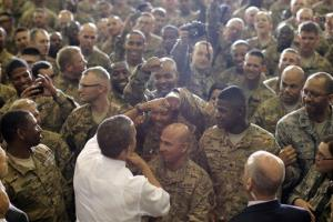 President Obama greets service members after he addressed troops at Bagram Air Field in Afghanistan.