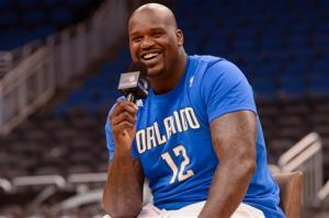 In this photo released by Chase on Saturday, March 31, 2012, Basketball legend Shaquille O'Neal greets cardmembers at the Marriott Rewards Premier Visa Signature Card from Chase event in Orlando, Fla.