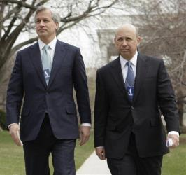 In this March 27, 2009, file photo, JP Morgan Chase & Co. Chief Executive Officer Jamie Dimon, left, and Goldman Sachs Chief Executive Officer Lloyd Blankfein leave the White House in Washington.