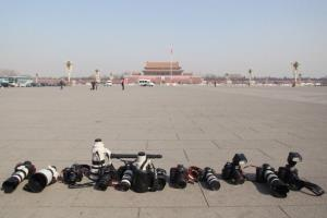 Photojournalists' cameras and lenses reamin in Tiananmen Square after the closing ceremony of the Chinese People's Political Consultative Conference in March.
