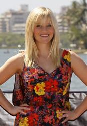 Reese Witherspoon, cast member in This Means War, poses for photographers before a press conference in Rio de Janeiro, Brazil, Friday March 9, 2012.