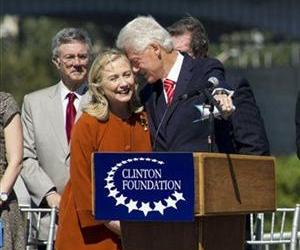 Bill Clinton whispers to Hillary before making an address in Little Rock, Ark. in this Sept. 30, 2011 file photo.
