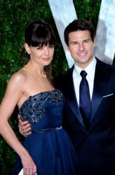 Katie Holmes and Tom Cruise arrives at the 2012 Vanity Fair Oscar Party hosted by Graydon Carter at Sunset Tower on February 26 in West Hollywood, California.