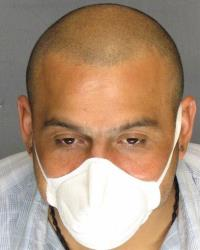 Armando Rodriguez wears a protective mask to protect others from his TB.