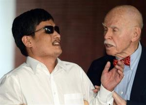 New York University Professor of Law Jerome Cohen, right, speaks to blind Chinese legal activist Chen Guangcheng after his arrival at the campus, Saturday, May 19, 2012, in New York.