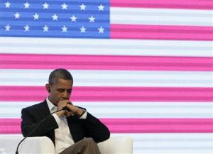 President Barack Obama is seen during a three-way conversation with the presidents of Brazil and Colombia, not pictured, at the CEO Summit of the Americas, in Cartagena, Colombia, April 14, 2012.