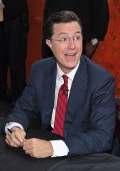 Stephen Colbert signs autographs for fans at the Third Man Records Rolling Record Store at The Lot at The High Line on June 24, 2011 in New York City.