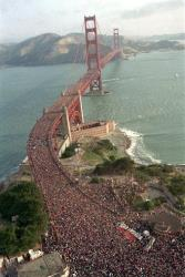 In this May 24, 1987 file photo, a crowd estimated at several hundred thousand jams the deck of the Golden Gate Bridge in San Francisco during a walk to celebrate the 50th anniversary of the bridge.