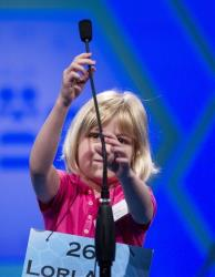 Six-year-old Lori Anne Madison, of Woodbridge, Va., reaches for the microphone during the second round, Wednesday, May 30, 2012, in Oxon Hill, Md.