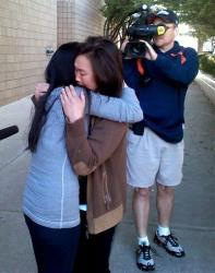 Bei Bei Shuai, 35, left, Indianapolis, hugs her friend, Sue Mak, after Shuai's release on bail from the Marion County Jail in Indianapolis on Tuesday, May 22, 2012.
