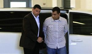 George Zimmerman, right, returns to the John E. Polk Correctional Facility after his bail was revoked.