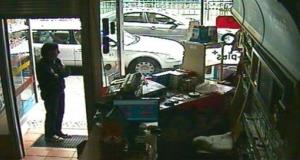 This image taken from CCTV shows a cafe worker in Berlin waiting for police to arrive to bust Magnotta.