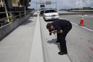 A crime scene investigator takes a photo at the scene of the horrific Miami attack. Now tourists want to take a look in a new tour.