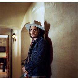 John Mayer, in a hat, doing his best Johnny Depp.