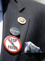 New York City Councilman Jumaane Williams displays several buttons as he speaks about the New York Police Department's stop and frisk policy yesterday.