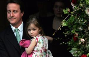David Cameron, his wife Samantha, and daughter Nancy leave the wedding of Alan Parker and Jane Hardman at Christ Church, Kensington on March 9, 2007, in London.