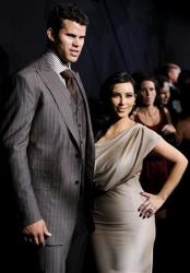 In this Aug. 31, 2011 file photo, newlyweds Kim Kardashian and Kris Humphries attend a party thrown in their honor at Capitale in New York.