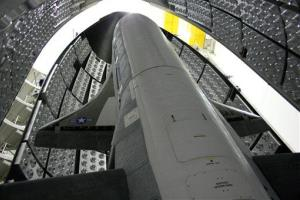 This April 2010 photo released by the US Air Force shows the X-37B Orbital Test Vehicle in the encapsulation cell at the Astrotech facility in Titusville, Fla.