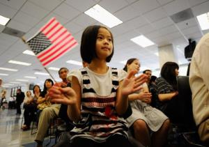 Jenny Ye, an 8-year-old, from China, celebrates her new US citizenship after a ceremony in Los Angeles.