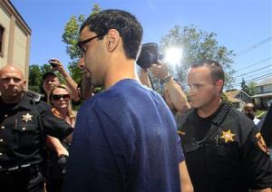 Dharun Ravi, 22, is photographed by the media as he arrives at the Middlesex County sheriff's department  in New Brunswick, N.J., Thursday, May 31, 2012.