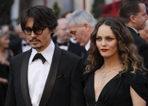 Johnny Depp and Vanessa Paradis arrive for the Academy Awards.