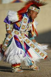 A young Navajo performs a traditional dance performance in Gallup, New Mexico.