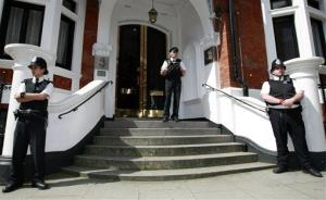 Police stand guard outside the Ecuadorian Embassy, London, Wednesday June 20, 2012. WikiLeaks chief Julian Assange has made a run for the Ecuadorean Embassy in London, seeking asylum in a long shot move that, if successful, would place him in a small, friendly South American country rather than in Sweden...