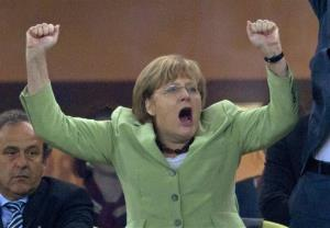 German Chancellor Angela Merkel celebrates during the Euro 2012 soccer championship quarterfinal match between Germany and Greece in Gdansk, Poland.