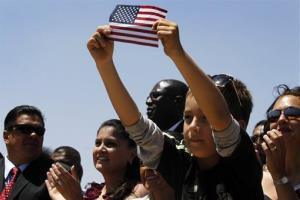 In this May 10, 2011 file photo, audience members listen to President Barack Obama speak about immigration reform at Chamizal National Memorial Park in El Paso, Texas.