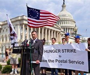 Rep. Dennis Kucinich, D-Ohio, and activists from the Postal Workers Union, make appeals to Congress to save the U.S. Postal Service, Monday, June 25, 2012, on Capitol Hill in Washington.