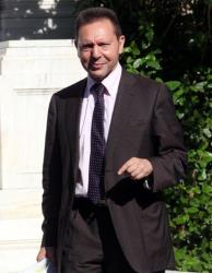 This May 22, 2012 file photo shows Yannis Stournaras leaving from Premier's office at Maximos Mansion. Stournaras was named the country's new finance minister earlier today.