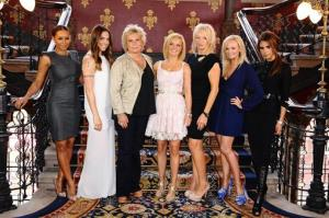Scriptwriter Jennifer Saunders, third from left, and producer Judy Craymer, third from right, pose with, from left Melanie Brown, Melanie Chisholm, Geri Halliwell, Emma Bunton and Victoria Beckham.