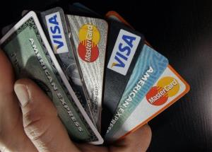 In this file photo, consumer credit cards are posed in North Andover, Mass.
