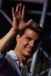 Tom Cruise waves as he attends the Premiere of Mission Impossible Ghost Protocol in Rio de Janeiro, Brazil, Wednesday Dec. 14, 2011.