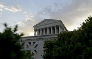 The Supreme Court in Washington, is seen as the sun rises, Thursday, June 28, 2012.