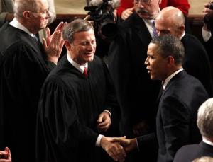 Supreme Court Chief Justice John Roberts greets President Barack Obama on Capitol Hill in Washington, Jan. 24, 2012, prior to the president's State of the Union address.