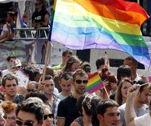 People march in a Gay Pride parade in Paris on June 30.