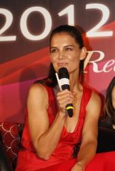 Katie Holmes reacts to questions during a press conference to promote an ice skating event Artistry on Ice in Taipei, Taiwan, Friday, June 8, 2012.