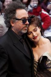 Director Tim Burton and Helena Bonham-Carter arrive for the British premiere of the film 'Dark Shadows' in London on May 9, 2012.