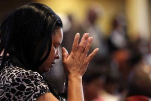 A congregation member prays at Franklin Avenue Baptist Church in New Orleans.