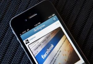 In this photo illustration, an Instagram photo of the Facebook website app is seen on an Apple iPhone on April 9, 2012 in New York City.