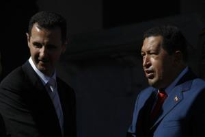 Venezuela's President Hugo Chavez, right, speaks with Syria's President Bashar al-Assad during a welcoming ceremony at Miraflores presidential palace in Caracas, Saturday, June 26, 2010.
