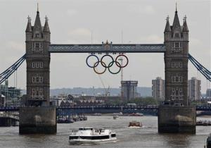 This Wednesday, June 27, 2012 file photo  shows the Olympic rings atop the iconic Tower Bridge over the river Thames in London, with one month to go until the start of London 2012 Games.