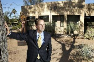 Bryan Howard, President and CEO of Planned Parenthood Arizona, poses in front of a Planned Parenthood facility in Tucson.