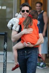 This July 17, 2012 photo shows actor Tom Cruise and daughter Suri Cruise leaving Chelsea Piers in New York.