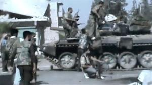 In this image made from video released by the Ugarit News and accessed July 23, 2012, Free Syrian Army soldiers sit on a military tank during clashes with Syrian government troops in Aleppo, Syria.